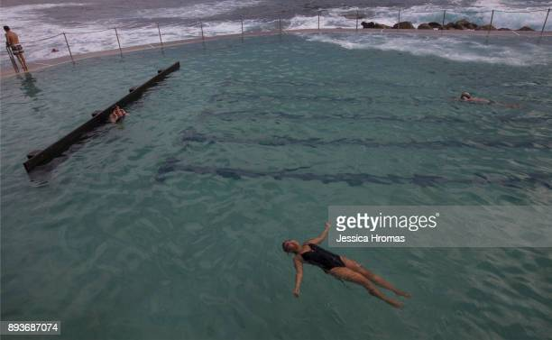 A woman floats on her back in the ocean pool at Bronte Beach on December 16 2017 in Sydney Australia Sydney has been sweltering though its first...