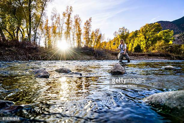 woman fly fishing eagle river - fly casting stock pictures, royalty-free photos & images