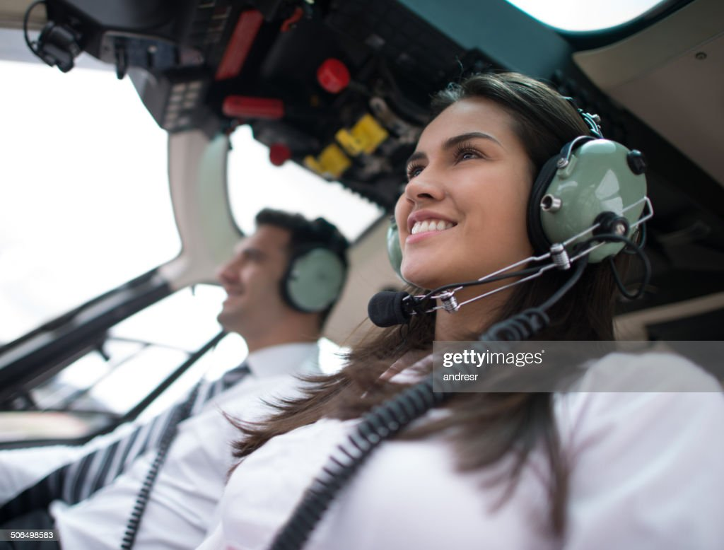 Woman flying a helicopter : Stock Photo