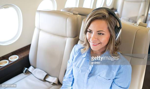 Woman flying and enjoying onboard entertainment