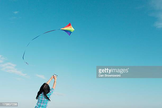 Woman flying kite outdoors