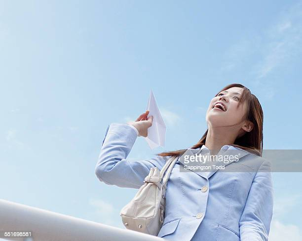Woman Flying Paper Airplane
