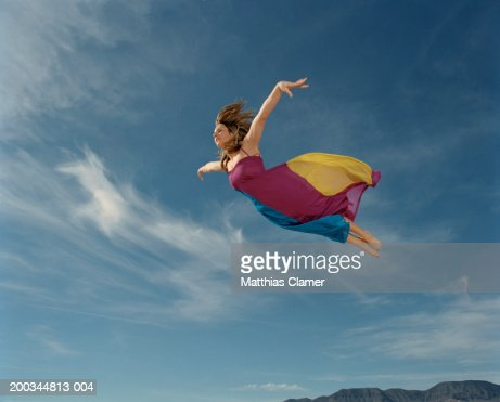 Woman Flying Through Sky Side View Stock Photo - Getty Images