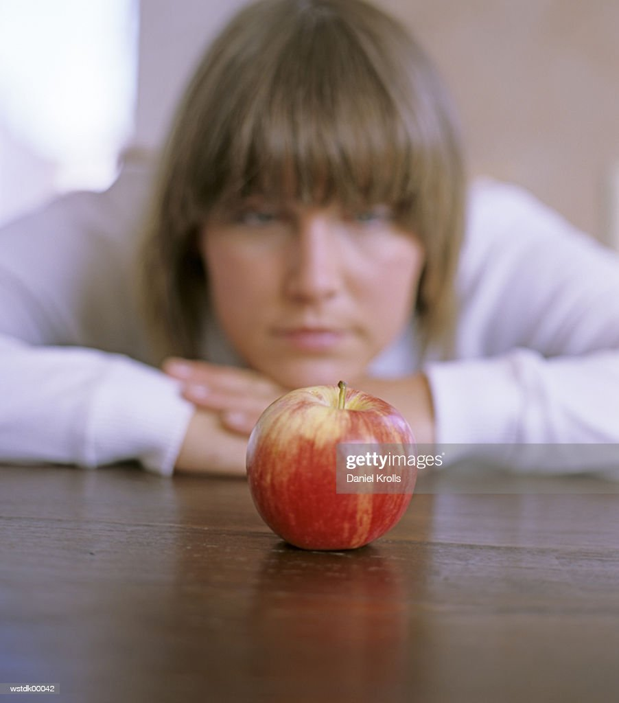 Woman, focus on apple : Stockfoto
