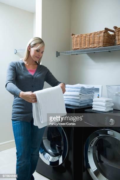 Woman Folding Laundry