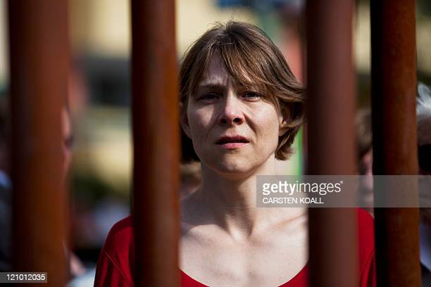 Woman follows the commemorative ceremony of the construction of the Berlin Wall at the Bernauer Strasse Memorial in Berlin on August 13, 2011. Berlin...