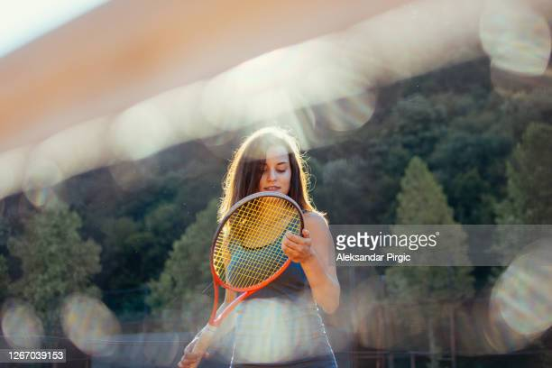 woman forcefully playing tennis - individual event stock pictures, royalty-free photos & images