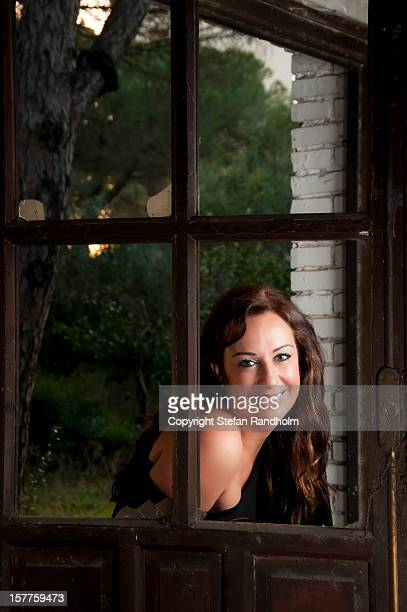 Woman framed by door panes
