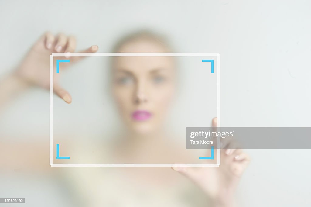 woman framing picture with hands : Stock Photo