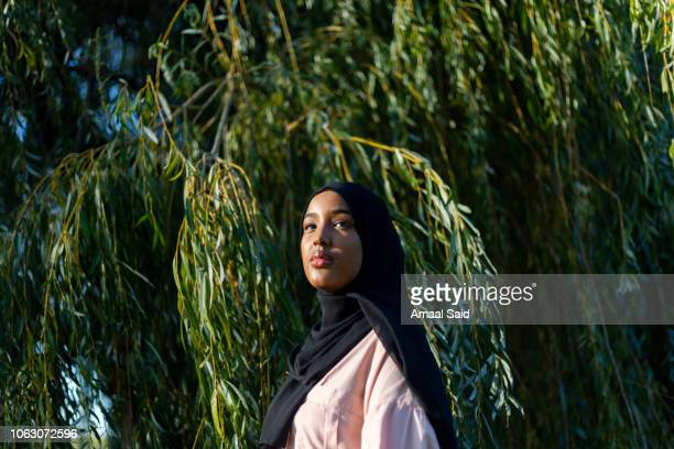 black woman in hijab in nature - showus stock pictures, royalty-free photos & images