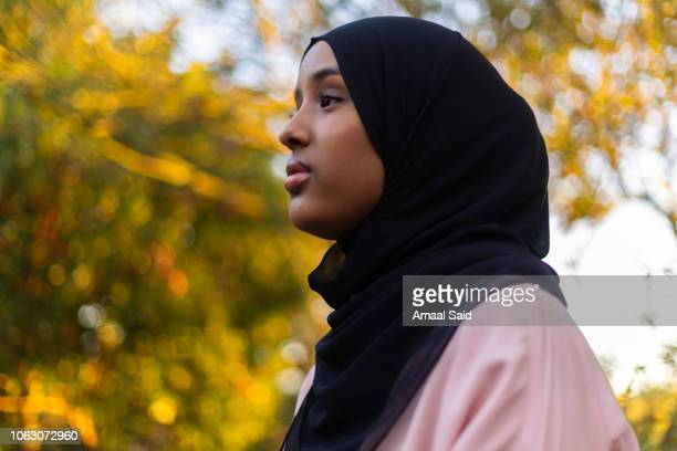 Black woman in hijab in nature