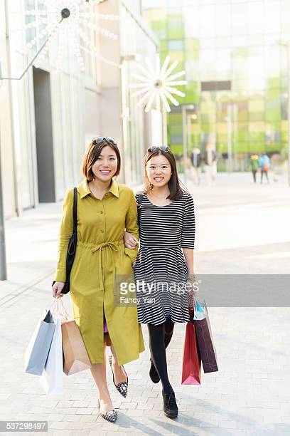 woman friends shopping together