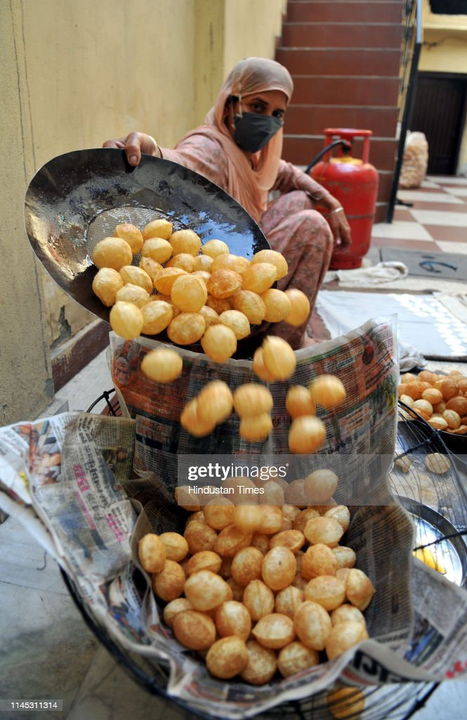 IND: Special Photo Feature On Indian Snack Pani Puri