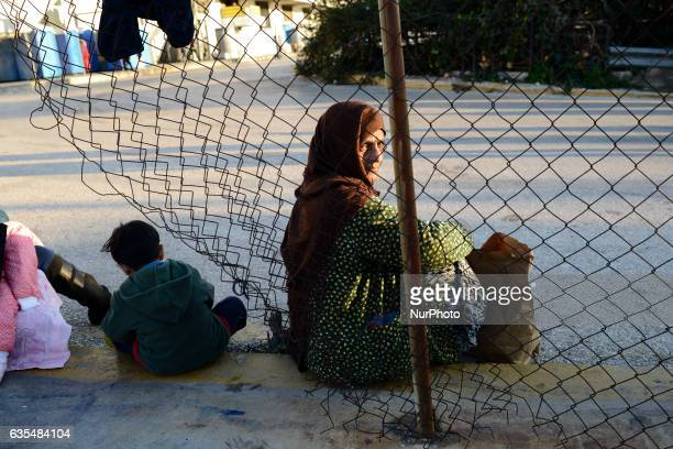 A woman from Afghanistan is seen at hellinikon camp in Athens on February 15 2017 Afghan refugees living at hellinikon camp have been protesting over...