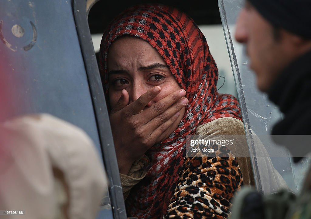 A woman from an Arabic family cries after her family was rejected to enter a Kurdish-controlled area from an ISIS-held village on November 16, 2015 near Sinjar, Iraq. Peshmerga forces carefully screened the displaced Iraqis as they arrived, fearing enemy infiltrators and suicide bombers. The Kurdish forces, with the aid of massive U.S.-led coalition airstrikes, liberated Sinjar from ISIL extremists, known in Arabic as Daesh, moving the frontline south to Ghabosyeh. About a thousand villagers from Ghabosyeh fled north to Kurdish held territory, to take refuge in camps or onward as refugees to Turkey or Europe.