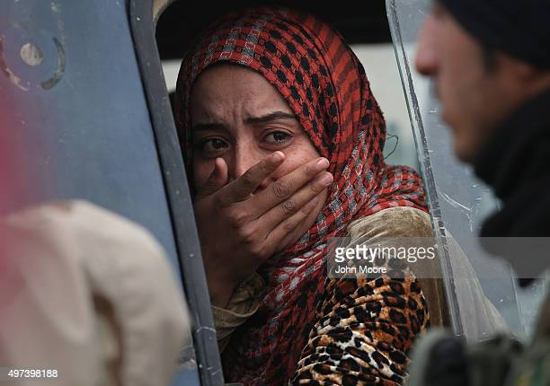 Woman from an Arabic family cries after her family was rejected to enter a Kurdish-controlled area from an ISIS-held village on November 16, 2015...