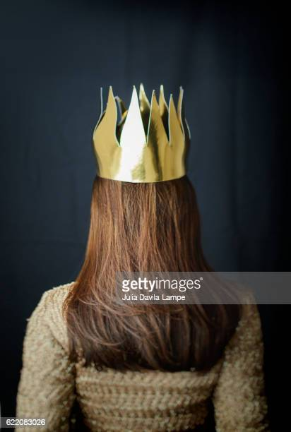 Woman from behing with gold crown.