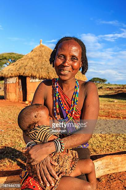 woman from borana tribe breastfeeding her baby, ethiopia, africa - adult breastfeeding photos stock pictures, royalty-free photos & images