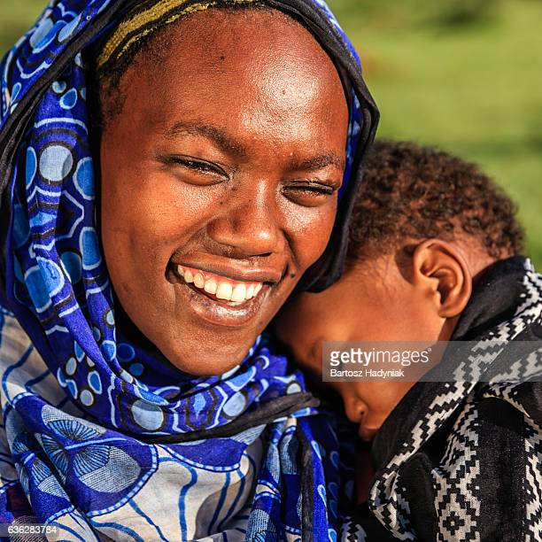woman from borana tribe holding her baby, ethiopia, africa - african tribal culture stock pictures, royalty-free photos & images