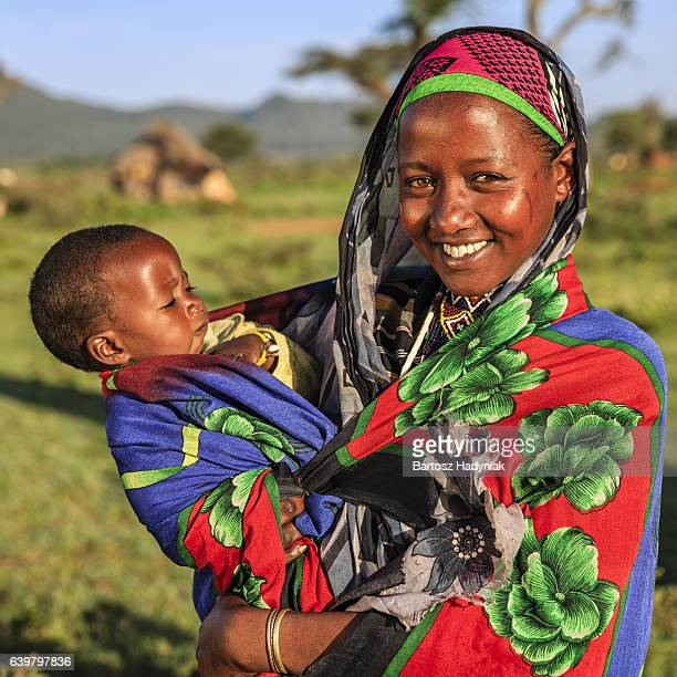 Woman from Borana tribe holding her baby, Ethiopia, Africa