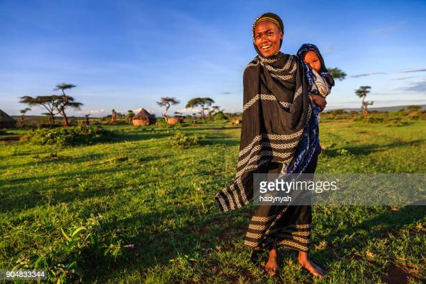 woman from borana tribe holding her baby, ethiopia, africa - ethiopia stock photos and pictures