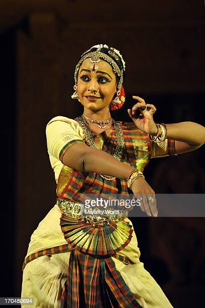 A woman from Divyanjali School of Classical Dance and Music Chennai performs Bharat Natyam on the annual Konark Dance and Music Festival held from...