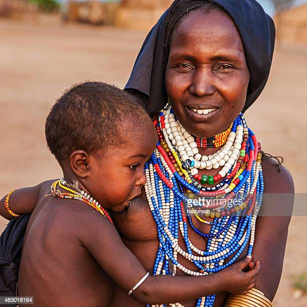 Woman from Erbore tribe breastfeeding her baby, Ethiopia, Africa