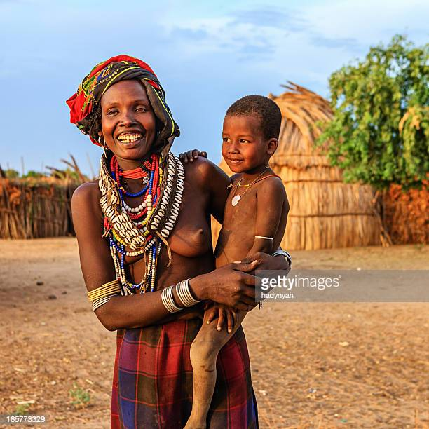 Woman from Erbore tribe holding her baby, Ethiopia, Africa