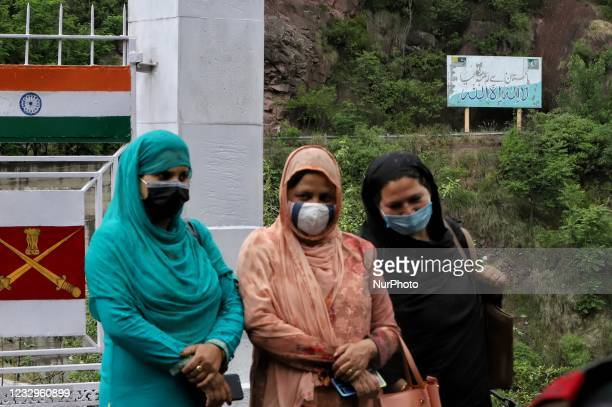 Woman from Indian Side stand near the Aman Setu bridge on LoC in URI sector of District Baramulla, Jammu and Kashmir, India on 18 May 2021....