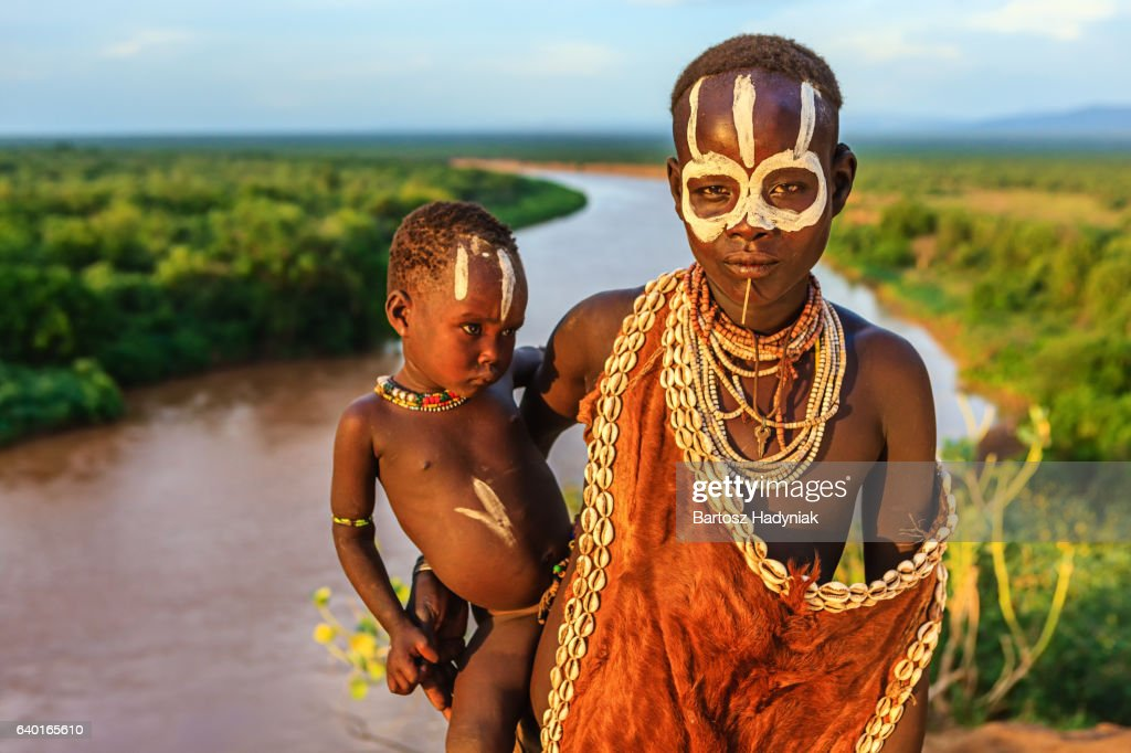 Woman from Karo tribe holding her baby, Ethiopia, Africa : Stock Photo