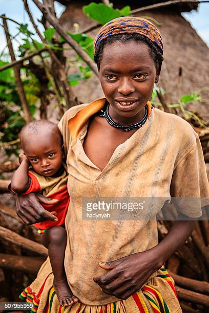 Woman from Konso tribe holding her baby, Ethiopia, Africa
