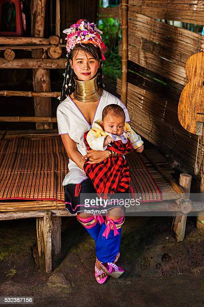 Woman from Long Neck Karen Tribe with her baby