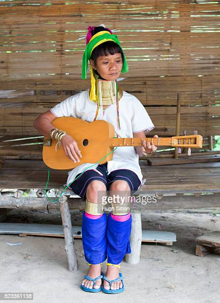 woman from long neck tribe playing guitar, chiang mai, thailand - hugh sitton stock-fotos und bilder