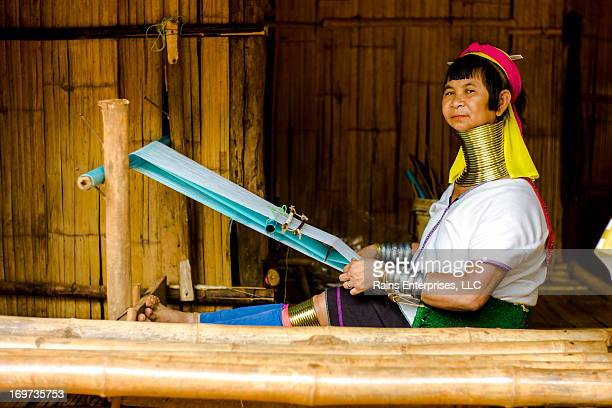 CONTENT] A woman from long neck tribe weaving a scarf