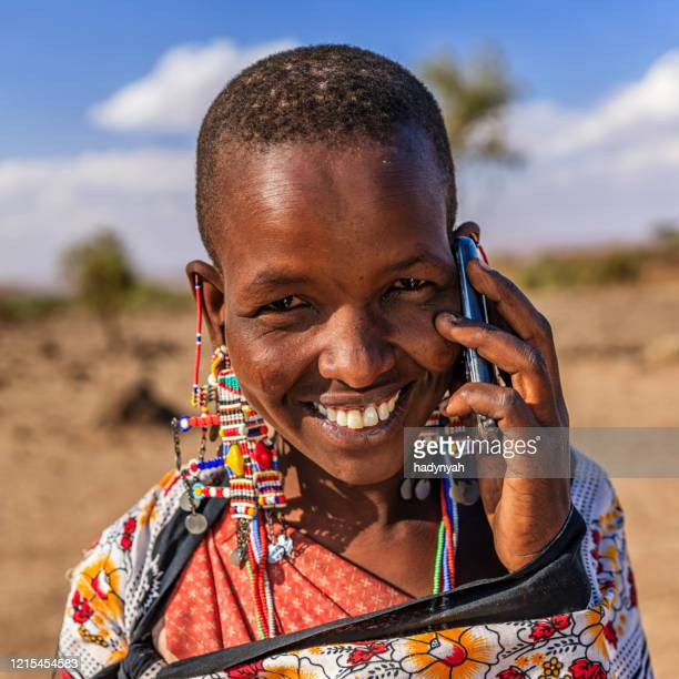 woman from maasai tribe using mobile phone, kenya, africa - east african tribe stock pictures, royalty-free photos & images