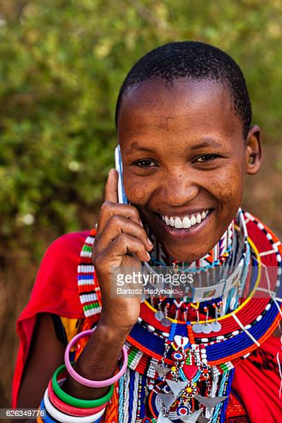 Woman from Maasai tribe using mobile phone, Kenya, Africa