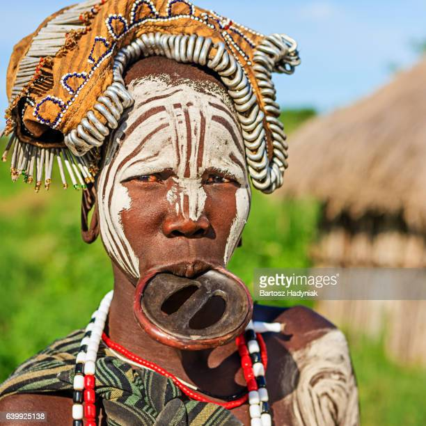 woman from mursi tribe with face paint, ethiopia, africa - lip plate stock photos and pictures