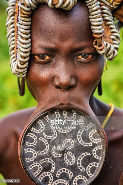 woman from mursi tribe with lip plate, ethiopia, africa - lip plate stock photos and pictures