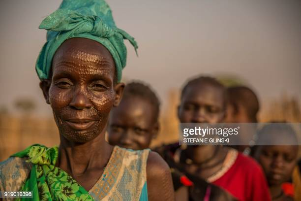 A woman from Nuer ethnic group poses in the early morning at the Protection of Civilian site in Bentiu South Sudan on February 16 2018 Bentiu's...