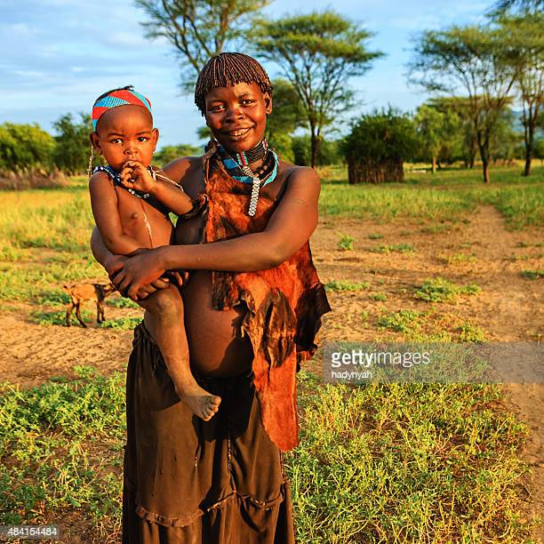 Woman from Samai tribe holding her baby, Ethiopia, Africa