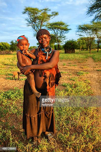 woman from samai tribe holding her baby, ethiopia, africa - african tribal culture stock pictures, royalty-free photos & images