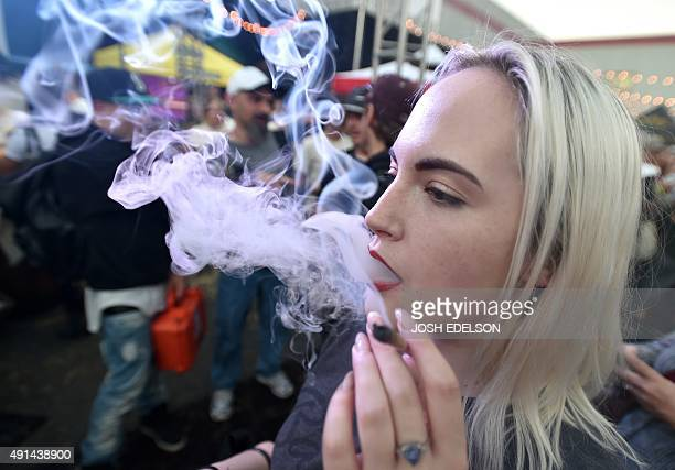A woman from Seattle smokes a joint at the first annual DOPE Cup a cannabis competition in Portland Oregon on October 4 2015 As of October 1 2015...