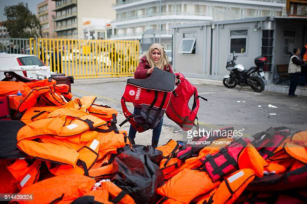 Woman from Syria cries after her luggage got lost after disembarking a vessel of the Greek Coast Guard, after trying to cross the sea from Turkey to...