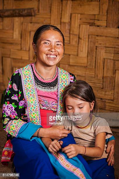 woman from the hill tribe with her daughter - laotian culture stock pictures, royalty-free photos & images