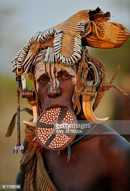 A woman from the Mursi tribe poses for a photo in the Mago National park near Jinka in Ethiopia's southern Omo Valley region on September 21 2016 The...