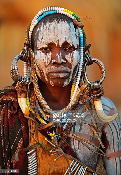 TOPSHOT A woman from the Mursi tribe poses for a photo in the Mago National park near Jinka in Ethiopia's southern Omo Valley region on September 21...
