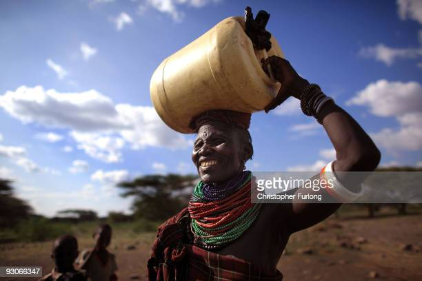 A woman from the remote Turkana tribe in Northern Kenya carries water from a well Some villagers are having to walk up to 10 miles to get fresh water...