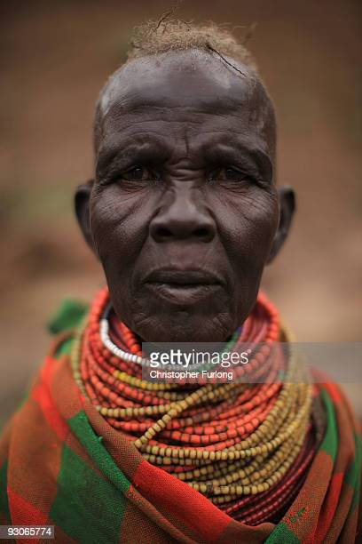 A woman from the remote Turkana tribe in Northern Kenya greets Oxfam workers as they arrive in her village of Kataboi to register villagers for food...