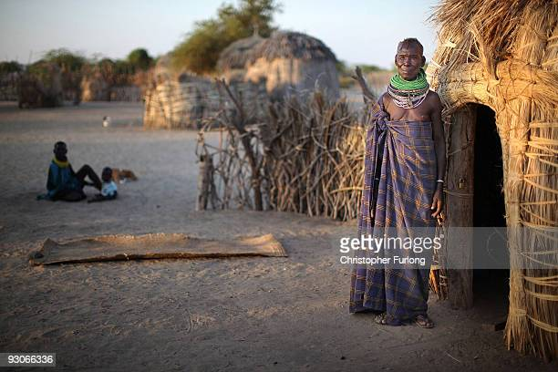 A woman from the remote Turkana tribe in Northern Kenya stands outside her manyatta home in the village of Kataboi on November 9 2009 near Lodwar...