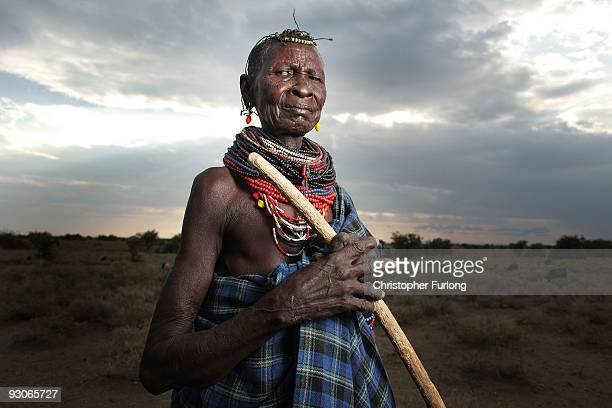 A woman from the remote Turkana tribe in Northern Kenya watches over her children on November 9 2009 near Lodwar Kenya Over 23 million people across...